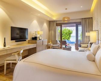 Lily Beach Resort & Spa - Huvahendhoo - Schlafzimmer