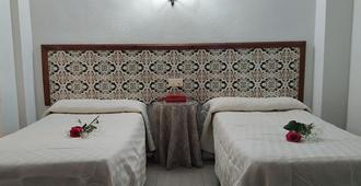 Pensión Eurosol - Granada - Habitación