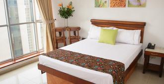 Hotel Alcaravan - Medellín - Yatak Odası