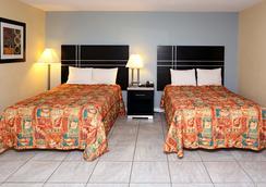 Blue Marlin Inn & Suites - Virginia Beach - Phòng ngủ