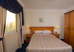 Gulf Pearl Hotel - Manama - Phòng ngủ