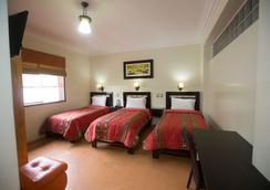 Hotel Tinkus Inn - Lima - Schlafzimmer