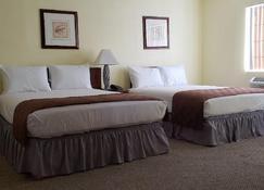 Europa Inn & Suites - Desert Hot Springs - Bedroom