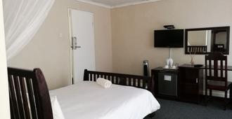 Lepatino Bed & Breakfast - Livingstone - Schlafzimmer