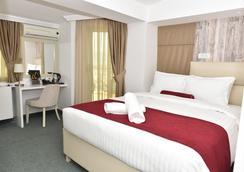 View Inn Boutique Hotel - Σκόπια - Κρεβατοκάμαρα