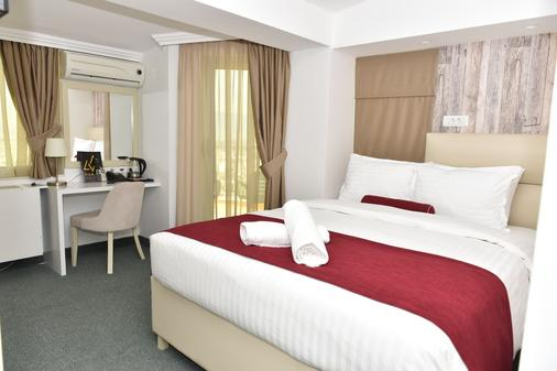 View Inn Boutique Hotel - Skopje - Phòng ngủ