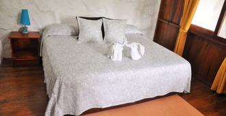 拉瓦之家旅館 - 阿約拉港 - 臥室