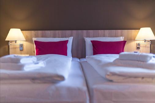 Luther-Hotel Wittenberg - Lutherstadt Wittenberg - Bedroom