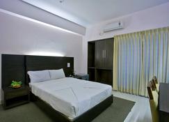 Nirvana Inn - Силхет - Спальня