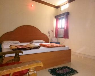Mohit Paying Guest House - Benares - Slaapkamer