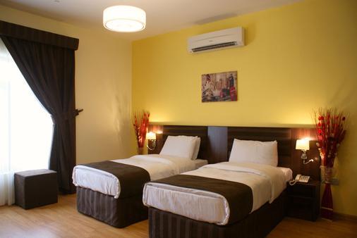 Weekend Hotel & Apartments - Muscat - Bedroom