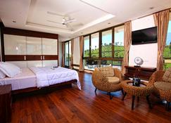Chateau Woods Resort - Meppādi - Спальня