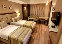 Krios Hotel - Ahmedabad - Schlafzimmer