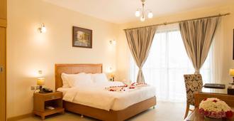 Lotos Inn & Suites, Nairobi - Nairobi - Phòng ngủ
