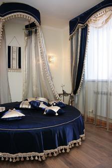 Academy Hotel - Kurgan - Schlafzimmer