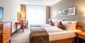 Leonardo Hotel Hamburg Airport - Hampuri - Makuuhuone