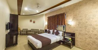 Rudra Mahal Hotel - Ahmedabad - Bedroom