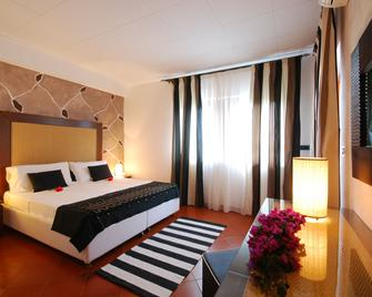 Cala Rosa Club Hotel - Сцинтио - Спальня