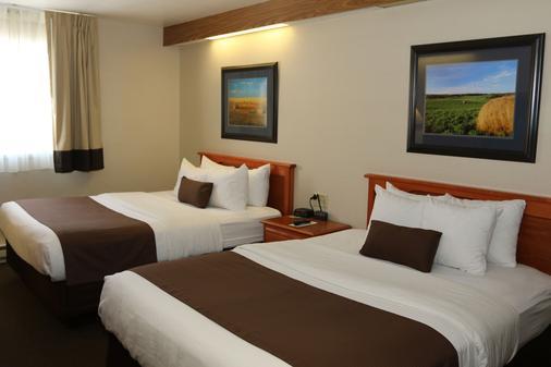 The Northern Plains Inn - Minot - Phòng ngủ