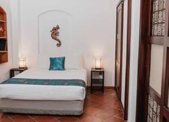 Hotel Galapagos Suites - Puerto Ayora - Bedroom