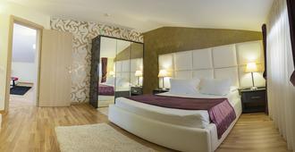 Hotel Corvaris - Bukarest - Schlafzimmer