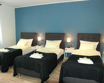 7th Room Guest House - Auschwitz - Schlafzimmer