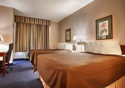 Magnuson Hotel Park Suites - Plano - Bedroom