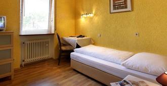 هوتل موجونتيا - ماينز - غرفة نوم