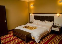 Mbayaville Hotel - Duala - Habitación