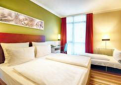 Leonardo Hotel & Residenz München - München - Makuuhuone