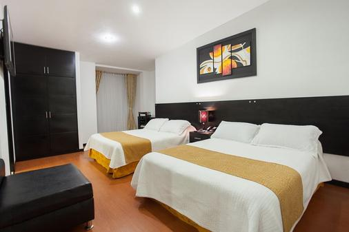 Hotel Palermo Suite - Pasto - Schlafzimmer