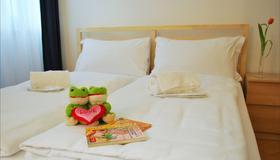 Lugano Center Guesthouse - Lugano - Phòng ngủ
