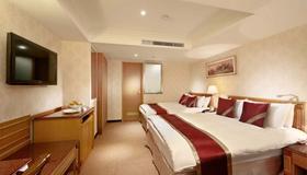 Cosmos Hotel Taipei - Taipei - Bedroom