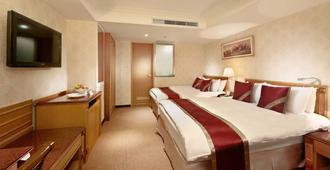 โรงแรมคอสมอส ไทเป - ไทเป - ห้องนอน