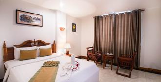 リラックス ホテル - プノンペン - 寝室