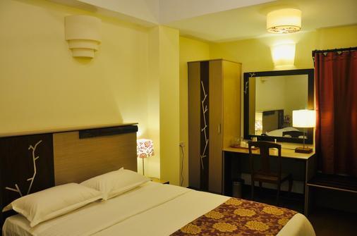 Annsun Boutique Hotel - Chennai - Makuuhuone