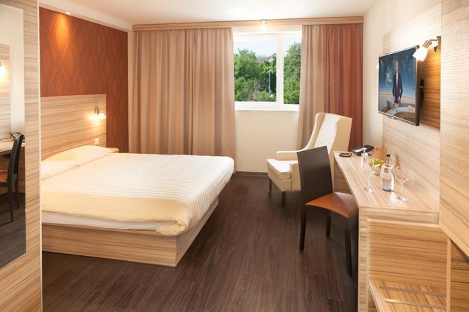 斯圖加特機場會展中心凱富星辰酒店 - 斯圖加特 - 司徒加特 - 臥室