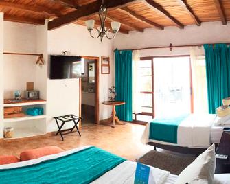 Isamar Hotel - Puerto Villamil - Slaapkamer