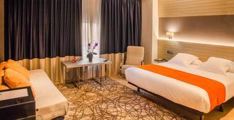 Hotel Avenida - א קורונה - חדר שינה