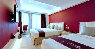 The Bauhinia Hotel - Central - Hong Kong - Camera da letto