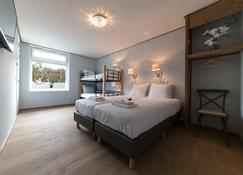 羊角村酒店 - 希特霍倫 - 臥室