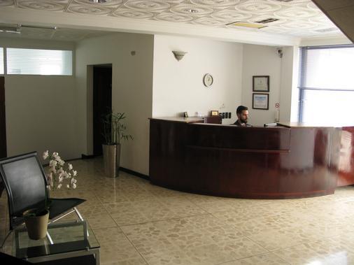Apartotel La Perla - San José - Front desk