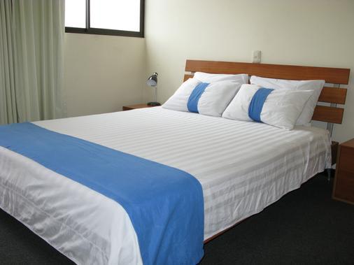 Apartotel La Perla - San José - Bedroom