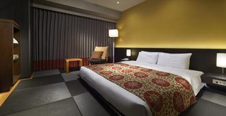 Hotel Sunroute Plaza Shinjuku - טוקיו - חדר שינה
