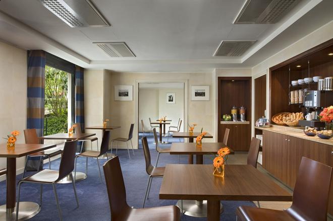 馨樂庭巴黎德芬斯酒店 - 庫爾伯瓦 - 庫伯瓦 - 餐廳