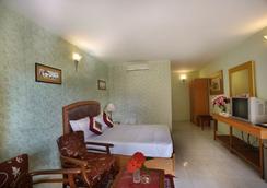 Jayamahal Palace Hotel - Bengaluru - Bedroom