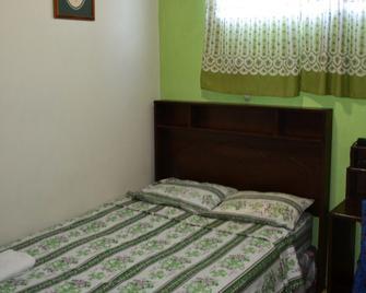Hotel Oasis - San Salvador - Slaapkamer