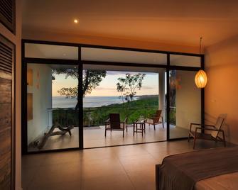 Hotel Boutique Lagarta Lodge - Nosara - Bedroom