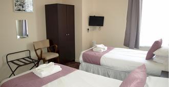 Burlington Hotel - 桑當 - 臥室