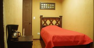 Melrost Airport Bed & Breakfast - Alajuela - Bedroom